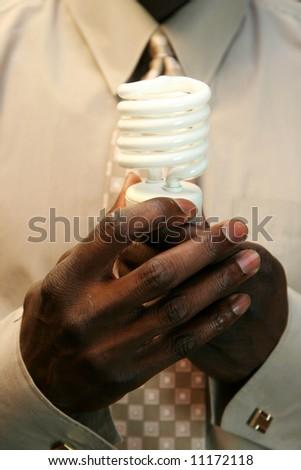 Man holding a lightbulb - stock photo