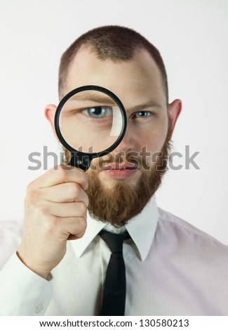 man holding a magnifying glass - stock photo
