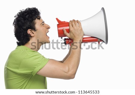Man holding a megaphone and shouting - stock photo
