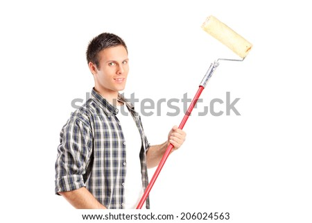 Man holding a paint roller isolated on white background - stock photo