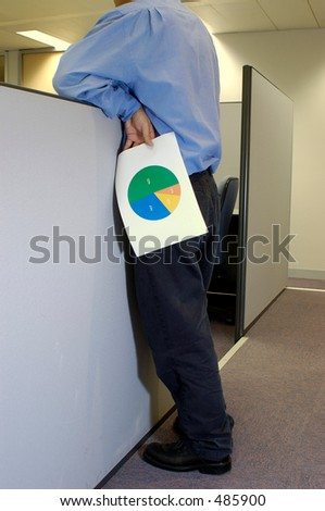 man holding a pie chart leaning over cubicle - stock photo