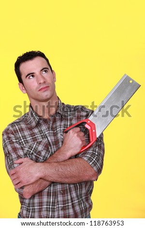 Man holding a saw - stock photo