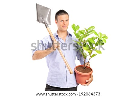 Man holding a shovel and a plant isolated against white background - stock photo