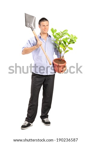 Man holding a shovel and a plant isolated on white background - stock photo