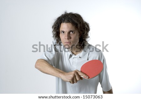 Man holding a table tennis paddle wears a serious expression on his face. Horizontally framed photograph. - stock photo