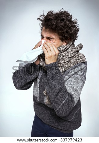 Man holding a tissue on his nose / Flu or cold - sneezing men sick blowing nose.  Medication or drugs abuse, healthcare concept  - stock photo