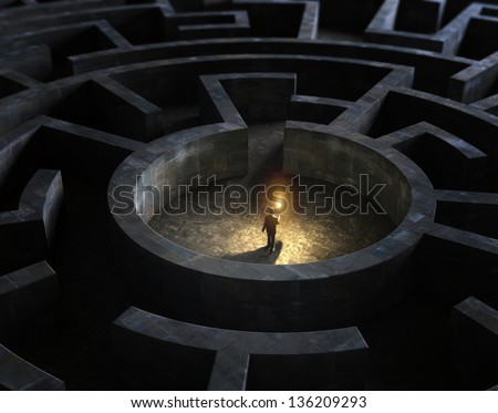 Man holding a torch in the middle of a mysterious maze - stock photo