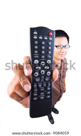 Man holding a TV remote control - stock photo