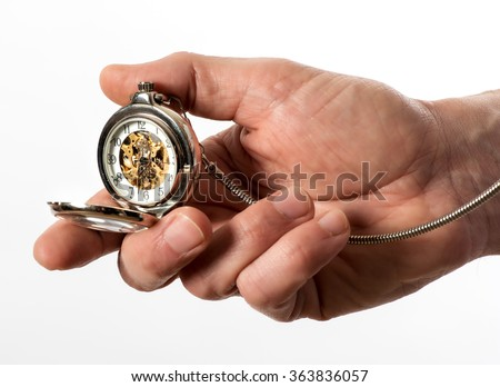 Man holding a vintage silver full hunter pocket watch in his hand opened to display the bronze mechanism through the glass dial, isolated on white - stock photo