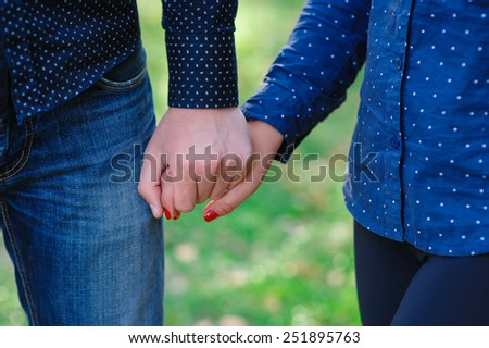 man holding a woman's hand. - stock photo