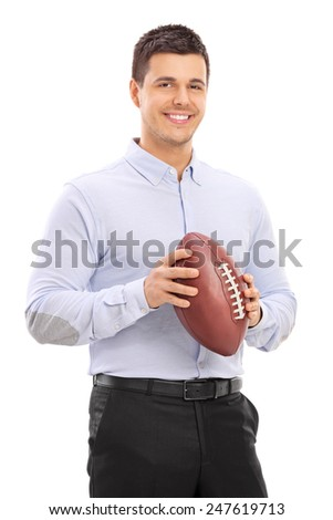 Man holding an American football and posing isolated on white background - stock photo