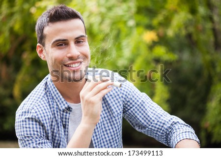 Man holding an electronic cigarette - stock photo