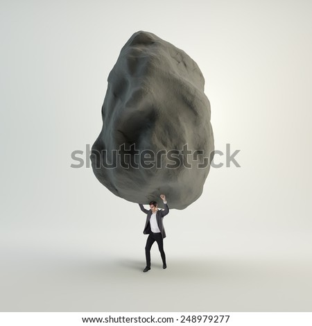 Man holding big stone concept - stock photo