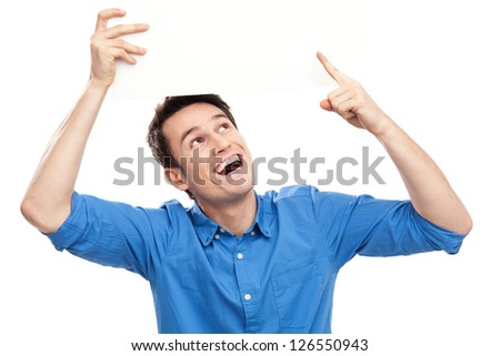 Man holding blank board above his head - stock photo