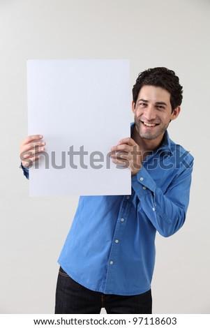 Man holding blank paper - stock photo