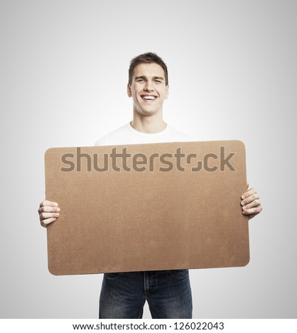 man holding blank poster on a white background - stock photo