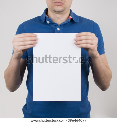 man holding blank sign in hands - stock photo