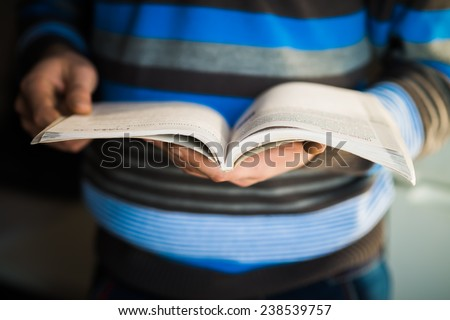 man holding   book - stock photo