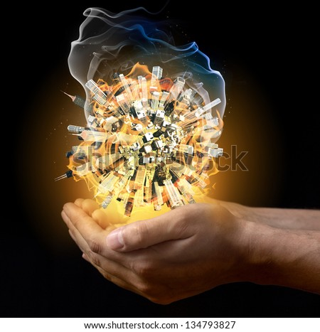 Man holding burning little word in his hand - stock photo