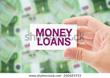 Man Holding Business Card with Money Loan Title, Euro Banknotes Pile in The Background. Loan Shark Concept. - stock photo