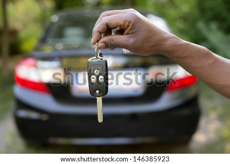 Man holding car keys - stock photo
