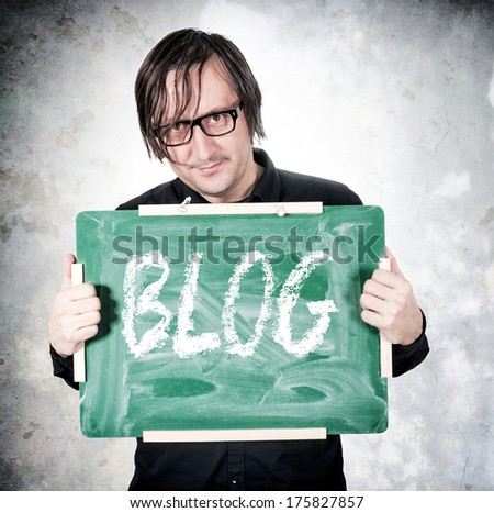 Man holding chalkboard with blog sign - stock photo