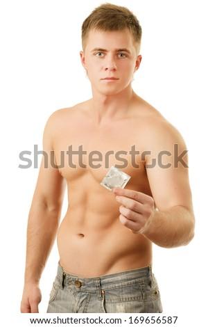 Man holding condom - stock photo