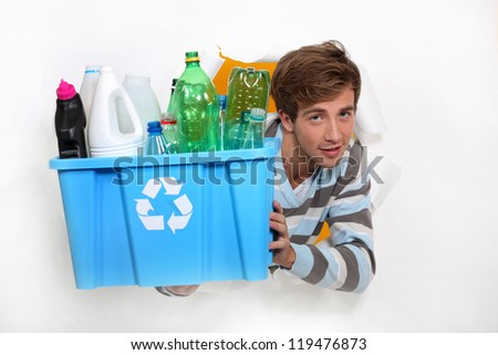 Man holding crate of bottles to be recycled - stock photo