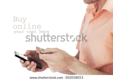 Man Holding Credit Card And Cell Phone Checking Account Balance. - stock photo