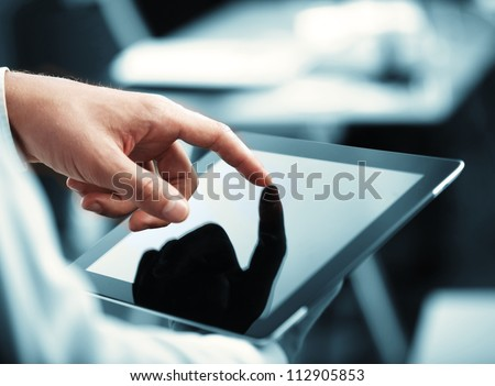 man holding digital tablet, closeup - stock photo