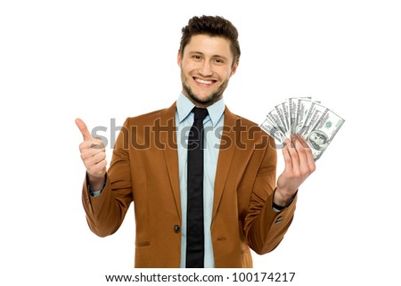 Man holding dollar bills - stock photo