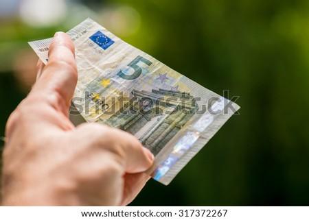 Man holding euro money - stock photo