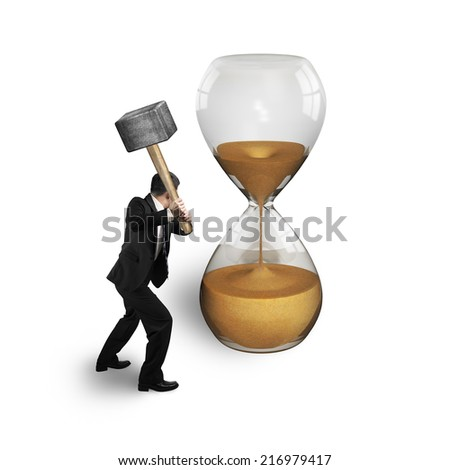 man holding hammer to hit hourglass isolated on white - stock photo