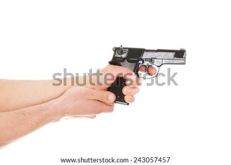 Man holding handgun and aiming - stock photo