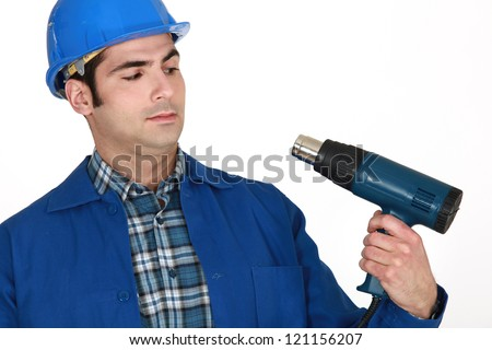 Man holding heater - stock photo