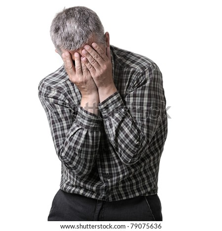 Man holding his head with his hands - migraine. sick and painful. - stock photo