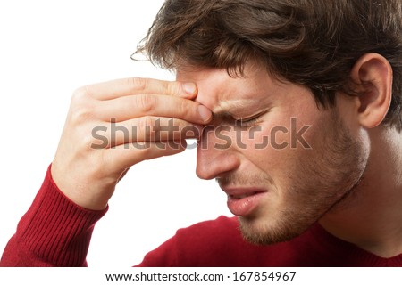 Man holding his nose because of a sinus pain - stock photo