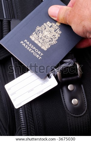 Man Holding His Passport And Suitcase  With A Blank Address Luggage Label - stock photo