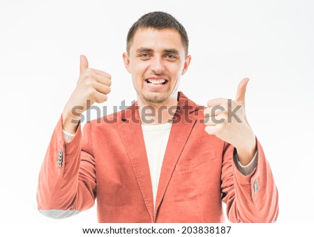 Man holding his thumb up - stock photo
