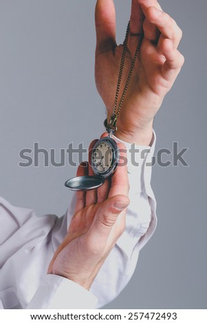 Man holding in his hands vintage watch clock - stock photo