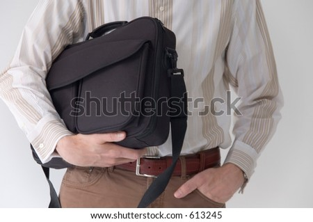 Man holding laptop case, detail - stock photo