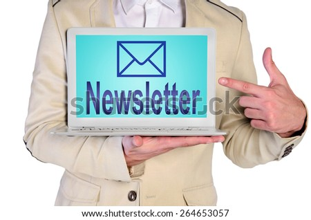 man holding laptop with newsletter - stock photo