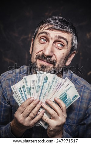 Man holding money in his hands - stock photo