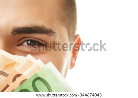 Man holding money isolated on white, closeup - stock photo