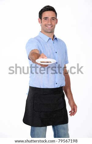 man holding out saucer - stock photo