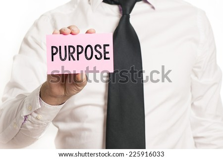 Man holding paper with purpose text isolated over white background - stock photo