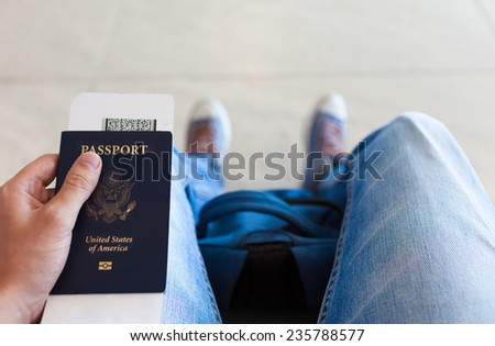 Man holding passport - stock photo