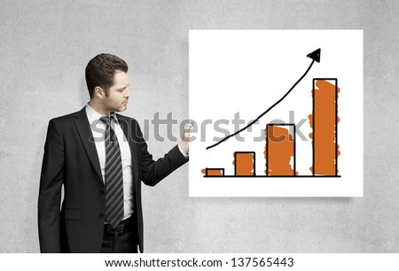 man holding poster with business chart - stock photo