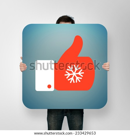 man holding poster with christmas like icon - stock photo