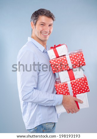 man holding presents for christmas - stock photo